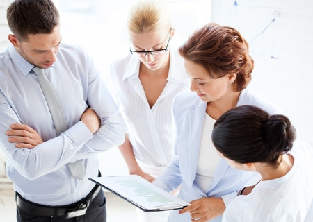 group goals: friendly business team having discussion in office