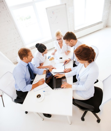 management meeting: business concept - friendly business team having meeting in office