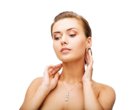 beauty and jewelry concept - woman wearing shiny diamond earrings Stock Photo - 20699514