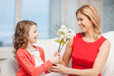 home and family - happy mother and daughter with flowers Stock Photo - 20785024