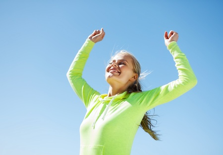 finish line: sport and lifestyle concept - woman runner celebrating victory Stock Photo
