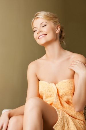 picture of happy woman in spa salon photo