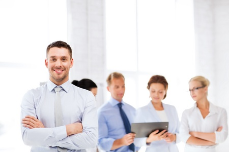 group  accountant: picture of smiling handsome businessman in office