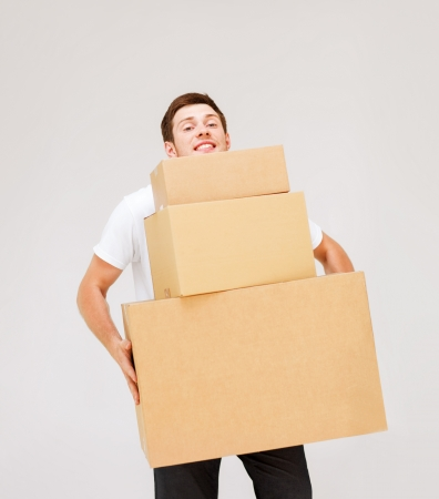 picture of young man carrying carton boxes Stock Photo