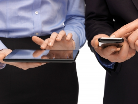 mobile app: woman and man hands with smartphone and tablet pc