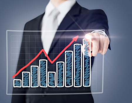 business and technology concept - businessman hand with chart on virtual screen photo