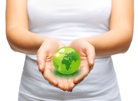 greenhouse and ecology: environment and technology concept - woman hands holding green sphere globe