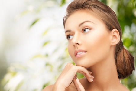 skincare facial: beauty and eco cosmetology concept - beautiful woman on nature Stock Photo