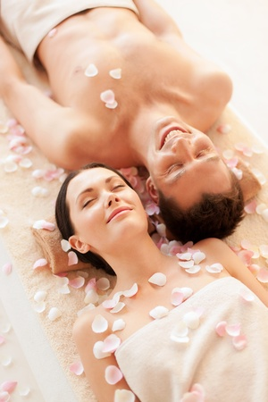 couples therapy: picture of couple in spa salon lying on the massage desks