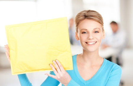 picture of businesswoman with parcel in office Stock Photo - 20772132