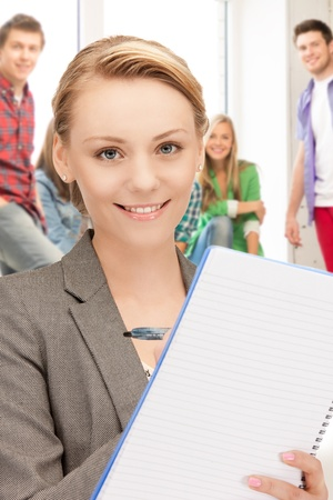 picture of smiling teacher with big notepad at school Stock Photo - 20772175