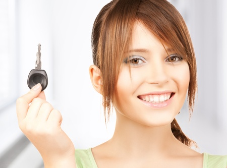 bright picture of smiling girl with car key