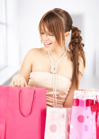 picture of happy girl with colorful gift bags photo