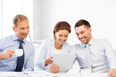 co workers: happy business team having fun with tablet pc in office Stock Photo