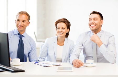 smiling business team discussing something in office photo