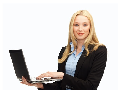 business and internet - smiling woman with laptop computer