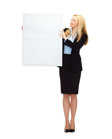 business and education - smiling businesswoman with white blank board photo