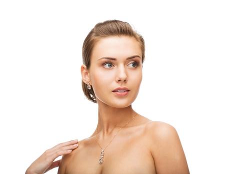 woman neck: beauty and jewelry concept - woman wearing shiny diamond earrings