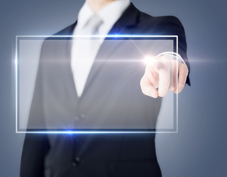 telecommute: future technology and business concept - male hand touching virtual screen Stock Photo