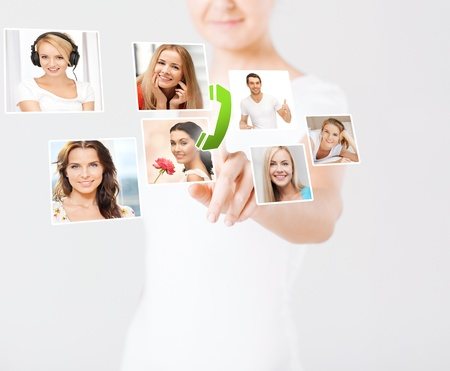 technology and communication - woman pressing button on virtual screen with contact icons photo