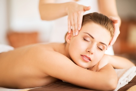 beauty parlor: beauty and spa concept - beautiful woman in spa salon getting massage