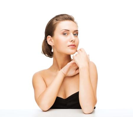 beauty and jewelry - beautiful woman wearing diamond earrings and wedding ring Stock Photo - 20818748