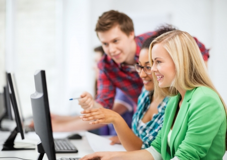 exam preparation: education concept - students with computer studying at school Stock Photo