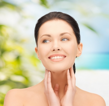 facial treatment: beauty and eco cosmetology concept - beautiful woman on nature Stock Photo