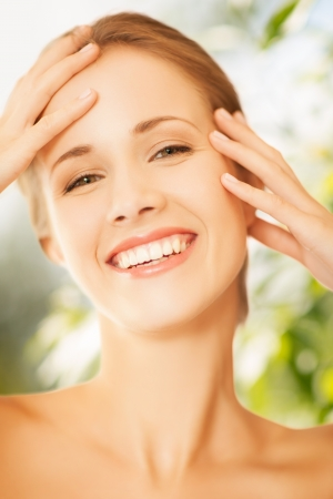 beauty and eco cosmetology concept - beautiful woman on nature photo