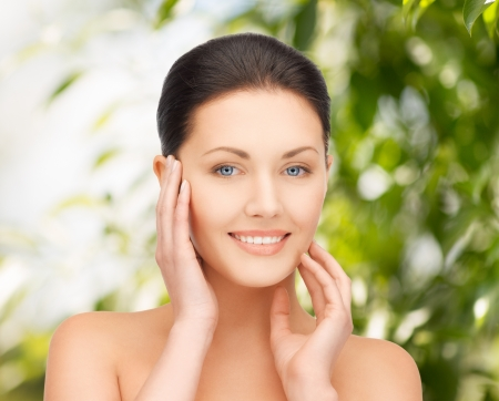 woman face cream: beauty and eco cosmetology concept - beautiful woman on nature Stock Photo