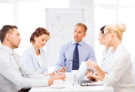business concept - business team having meeting in office Stock Photo