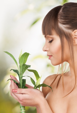 beauty and eco cosmetology concept - beautiful woman on nature with green sprout Stock Photo - 20859553