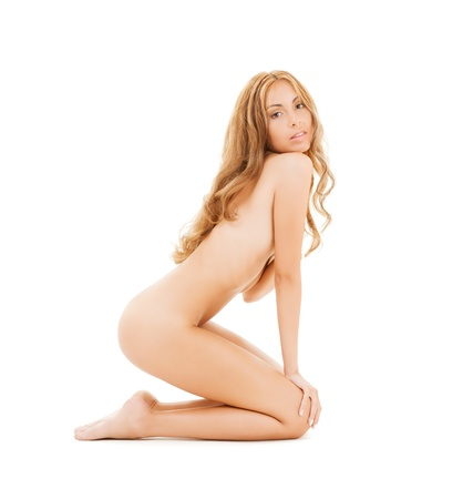 picture of attractive naked woman with long hair sitting on the floor photo