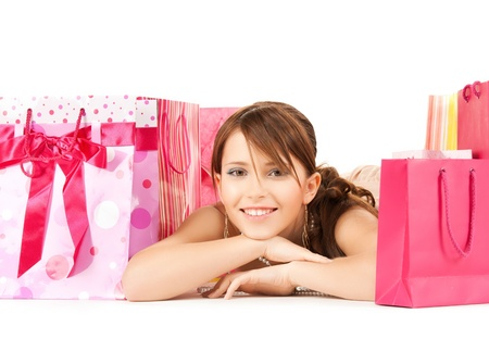 picture of happy girl with color gift bags photo