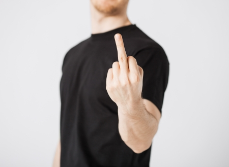close up of man showing middle finger Stock Photo