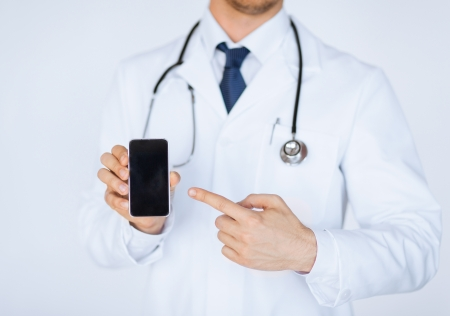 close up of male doctor pointing at smartphone photo