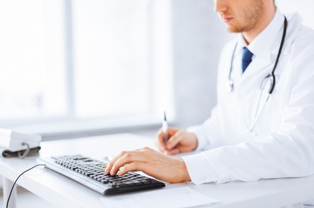 new medicine: close up of male doctor typing  on the keyboard Stock Photo