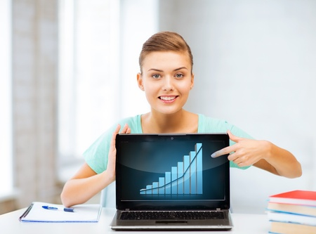 sales person: student showing laptop with graph Stock Photo