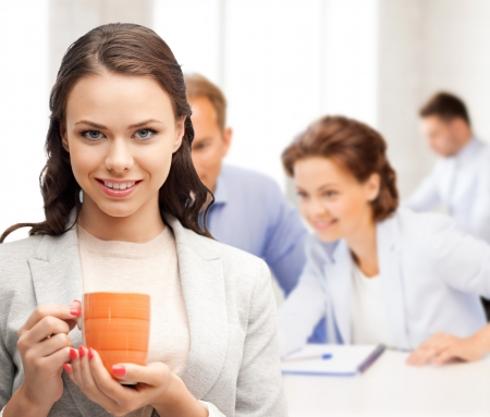 cup: business concept - beautiful businesswoman with cup of coffee