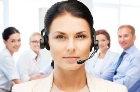 customer assistant: helpline operator with headphones in call centre