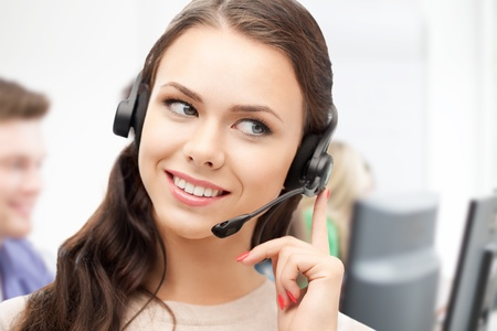 business and technology concept - helpline operator with headphones in call centre photo