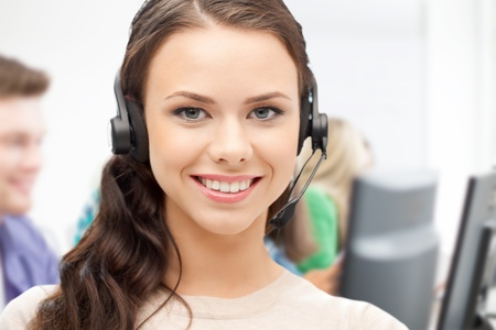 call center female: business and technology concept - helpline operator with headphones in call centre