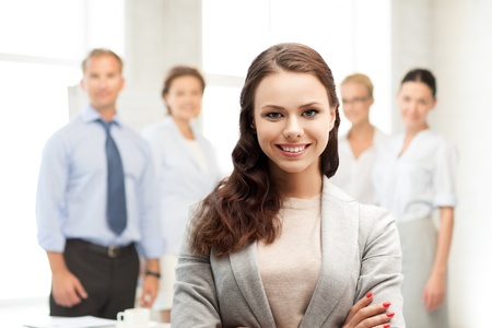 discussing: business concept - attractive young businesswoman in office