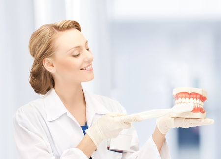 healthcare, medical and stomatology - doctor with toothbrush and jaws in hospital Stock Photo - 20956837
