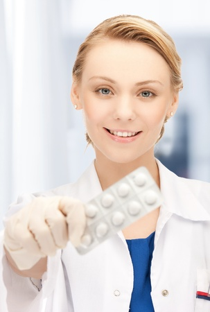 healthcare and medical concept - doctor with blister pack of pills in hospital Stock Photo - 20956842