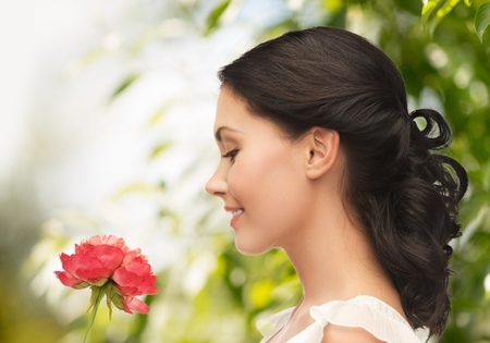 wedding and beauty concept - young woman with flower