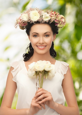 wedding and beauty concept - young woman with flower photo