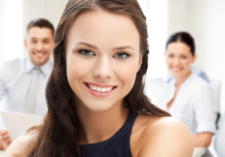 business concept - attractive young businesswoman in office photo