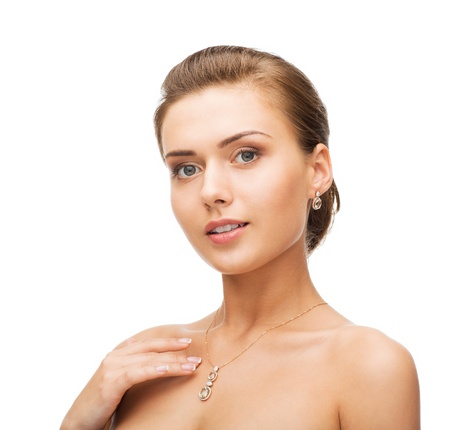woman wearing shiny diamond earrings photo