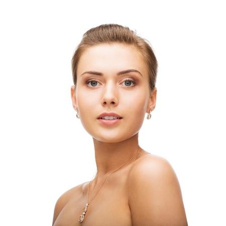 woman wearing shiny diamond earrings Stock Photo - 20924850